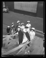 Ten student nurses boarding the U.S.S. Repose, San Pedro, 1949