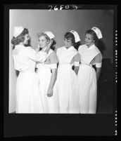 Mary Eilers, Mary Mayes, Santa Solomonian, and Janet Horsh at a nurse capping ceremony, Good Samaritan Hospital, Los Angeles, 1952