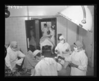 Student nurses and interns in an operating room, Queen of Angels Hospital, Los Angeles, 1956