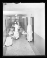 Medical staff and patients in corridor of Queen of Angels Hospital, Los Angeles, 1956