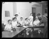 Nurses answering phones, California Hospital, Los Angeles, 1956