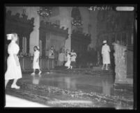 Georgia Ann Farmer kissing the ring of Cardinal McIntyre, St. Vincent's Church, Los Angeles, 1958