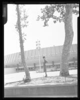 Woman posing in front of the Los Angeles Memorial Sports Arena, Los Angeles, 1960