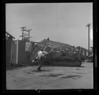 Jerry Gould supervises Bunny Asher as he bulldozes a house used for editing at Hal Roach Studios, Culver City, 1963