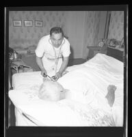 Nurse Tony Assinesi treating a patient, Los Angeles, 1965