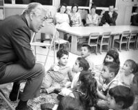 Cesar Romero visits elementary school class, Los Angeles, 1960s