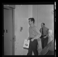 Bobby Augusta Davis being escorted to his murder trial by a deputy sheriff, Van Nuys, 1970
