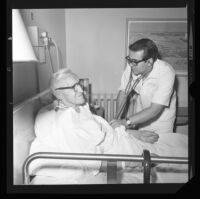 Robert Messerly, student nurse, attends to Holger Larson at Good Samaritan Hospital, Los Angeles, 1971
