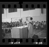 Reverend Patrick Joseph performing a Catholic mass, Pacific State Hospital, Pomona, 1974