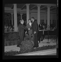 Bing Crosby greeting two men at a fundraiser at the Getty Villa, Los Angeles, 1975