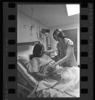 Nurse Pat Clinton with patient, Mt. Sinai Hospital, Los Angeles, 1976