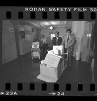State Senator Alan Robbins and Reverend W. C. Jackson wheeling antibusing initiative petitions into the Los Angeles County Registrar-Recorder's office, 1978