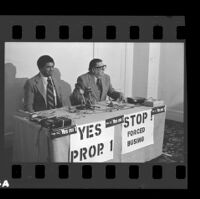 State Senator Alan Robbins with Howard Jarvis during a news conference to promote Robbins' antibusing measure Prop. 1, 1979