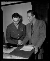 William Holden submits finger prints during enlistment, Los Angeles, 1942