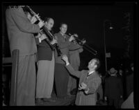 Dick Powell leads a band, Pasadena, 1942
