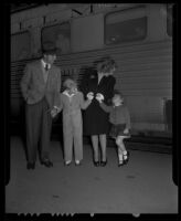 Dick Powell, Joan Blondell, Norman Powell, and Ellen Powell, Santa Fe Depot, Pasadena, 1942