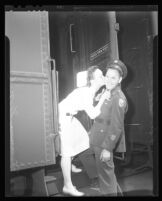 Army nurse Lt. Anne Wojcik and Pfc. Cecil Fleming aboard a train, Van Nuys, 1944