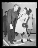 Pvt. Leroy Hood giving bowling instructions to Lt. Ruth Case at a recently built bowling alley in Birmingham Hospital, Van Nuys, 1945