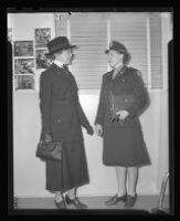 Two women talking, both wear military uniforms, Los Angeles, 1944