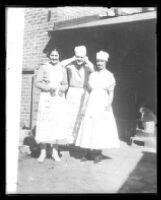 Clara Phillips standing with unidentified man and woman, between 1915-1922 (?)