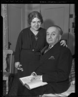 Author Ludwig Lewisohn and his wife Thelma pose with each other on a visit to Los Angeles, 1936