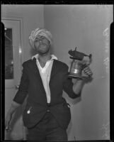 Prince Ucon holds a blowtorch for demonstration, Lincoln Heights, 1936