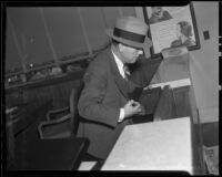 Leon Bone collecting fingerprints after bank robbery, Los Angeles, 1936