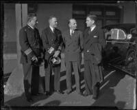 Chief James E. Davis, Public Works president Paul Ritter, and Richard Black greet Admiral Richard E. Byrd, Los Angeles, 1936