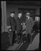 Chief James E. Davis and Public Works president Paul Ritter greet Admiral Richard E. Byrd, Los Angeles, 1936