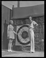 Virginia Chatterton and Barbara Riley survey their archery results, Palm Springs, 1936