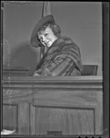 Iris Adrian, actress, in the witness stand after a divorce from Charles Henry Over, Jr., Los Angeles, 1936