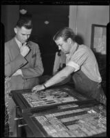 Mayor Halsey Fink watches Dwain Galbraith prepare an issue of the Los Angeles Times, Los Angeles, 1936