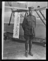 Military aviator Morey H. Downs beside and airplane, 1926