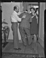 D. A. and Helen Williams reenact robbery at neighbor's home, Los Angeles, 1936