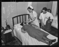 Doris Dick is treated by Nurses Alta May Stuart and William Partin, Los Angeles, 1936