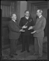 Frank Shaw receives a special birthday cake with Justice Minor Moore and Chief James Davis, Los Angeles, 1936