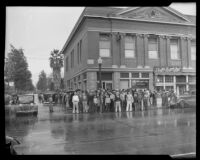 A crowd gathers after a robbery at the Southern County Bank, El Monte, 1936