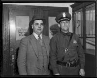 E. S. Strong and R. E. Foell pose for a photograph at the police station, El Monte, 1936