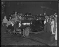 Spectators gather around the getaway car used in the robbery of Southern County Bank, El Monte, 1936