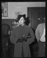 Ann Smith held for questioning after late husband's bank robbery, Los Angeles, 1936