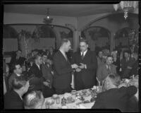 Lieut. C. J. Dickinson presents pistol and belt to Chief James E. Davis, Los Angeles, 1936