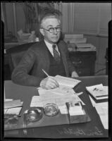 Lon W. Butler at his desk, Los Angeles, 1936