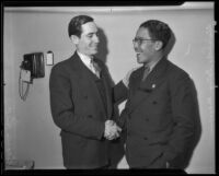 Mexican Consuls Ricardo Hill and Alejandro Gomez Maganda shake hands, Los Angeles, 1936