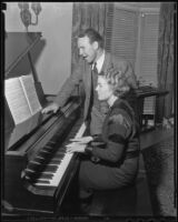 Boxer Jimmy McLarnin sings while his wife, Lillian, plays the piano, Beverly Hills, 1936