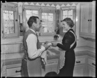 Boxer Jimmy McLarnin and his wife, Lillian, do the dishes, Beverly Hills, 1936