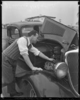 Boxer Jimmy McLarnin fixes his car for the camera, Beverly Hills, 1936
