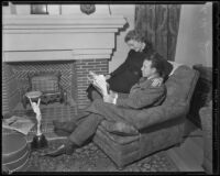Boxer Jimmy McLarnin and his wife, Lilian, read a newspaper together, Beverly Hills, 1936