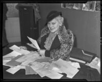 Silent film star Juanita Hansen sorts through fan mail at the W.P.A. unit office of 1050 Santee Street, Los Angeles, 1936