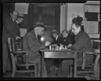 Chess and Checker Club members M. Starker and Holgar Johansen play a game, Los Angeles, 1936