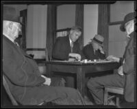 Checker champion Leonard Leslie Hall and H. P. Kidwell play separate games, surrounded by other club members, Los Angeles, 1936